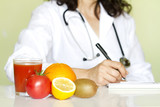 Fototapety Doctor nutritionist in office with healthy fruits diet concept