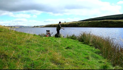 man fishing at grassholme reservoir uk