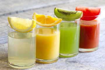 Fresh juice in glass with slices of fruits and vegetables