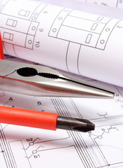 Electrical diagrams and work tools on construction drawing