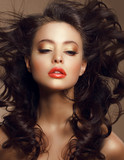 Sexy Woman with Long Windy Brown Hair and Saturated Makeup