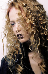 Charisma. Individuality. Young Woman with Curly Hairs