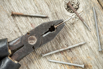 Old used pliers with nails