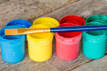Watercolor paints with  paintbrush