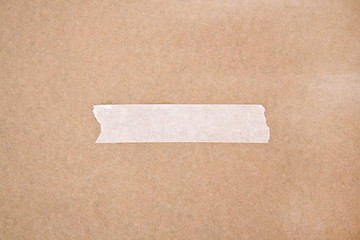 Adhesive tape on brown paper