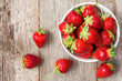 canvas print picture - Red strawberry in a bowl