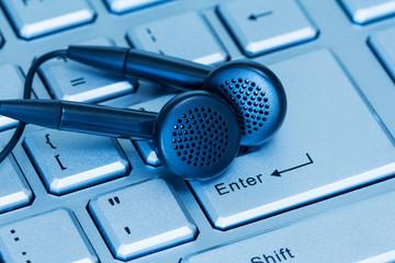Headphones and computer keyboard