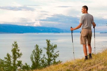 Hiker near the beautiful view of lake
