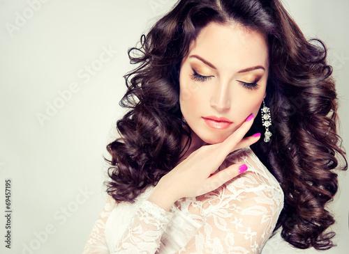 Leinwandbild Motiv Model  brunette  with curly hair