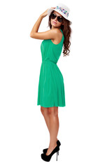 woman in green dress and sun hat isolated on white background