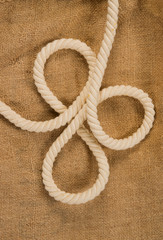 rope with a loops on a background of sackcloth