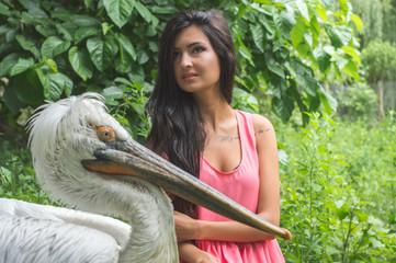 Woman and Dalmatian Pelican