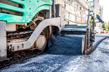 industrial truck laying fresh bitumen and asphalt