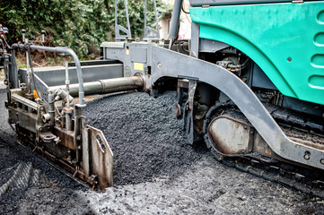 detail of asphalt paver machine during road construction