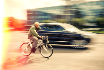 Cyclist and a car on the street