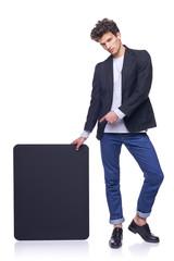 Full length man holding empty frame