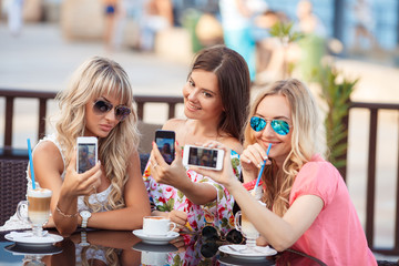 Beautiful women, photographing a phone