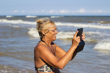 elderly woman with electronic tablet