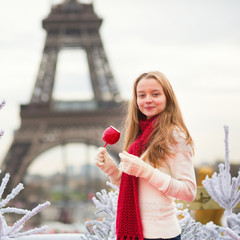 Girl with caramel apple in Paris
