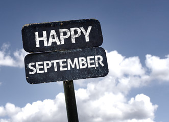 Happy September sign with clouds and sky background