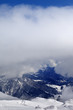 Winter snowy mountains in clouds