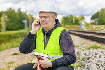 Railroad maintenance worker talking on the phone
