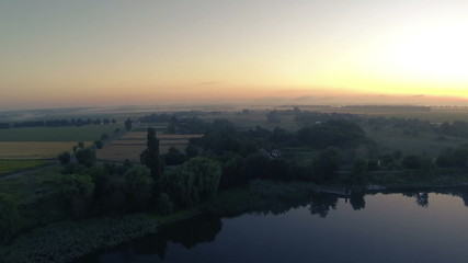 Lake panorama with fields at sunrise.  Aerial  landscape