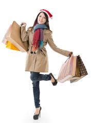 Christmas shopping girl holding bags