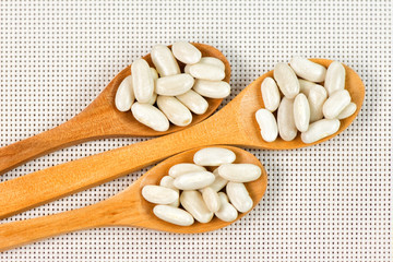 Beans in wooden spoons