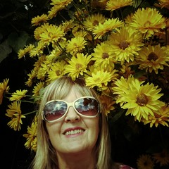 Happy Woman with yellow flowers