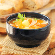 Bowl of delicious homemade salmon soup with vegetables