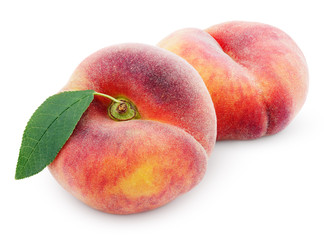 Two chinese flat donut peaches with leaf isolated on white