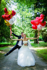 caucasian wedding couple with balloons