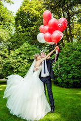 Couple of bride and groom with balloons