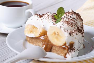 Piece of banana cake and coffee close-up horizontal