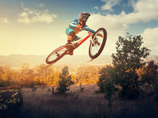 Man high jump on a mountain bike. Downhill cycling.