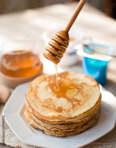 canvas print picture Pancakes with honey on the kitchen table
