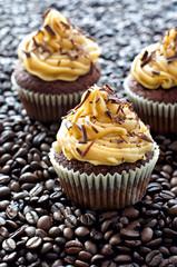 Chocolate cupcakes  with caramel cream on coffee beans sample te