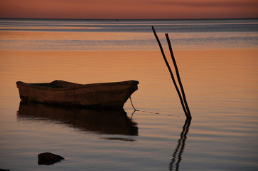 Small boat at sunset
