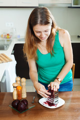 woman cooking  boiled beets with grater
