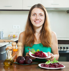 Young woman in green with boiled beets