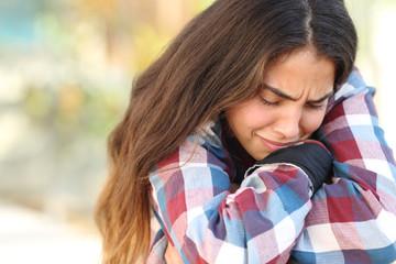 Teenager girl worried and sad outdoors