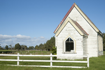 Small white church with white fence