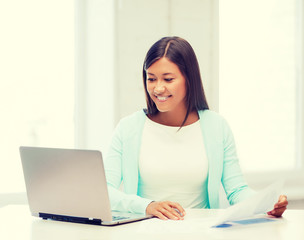 asian businesswoman with laptop and documents