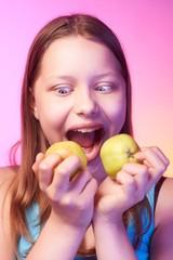 Emotional funny teen girl eating apple