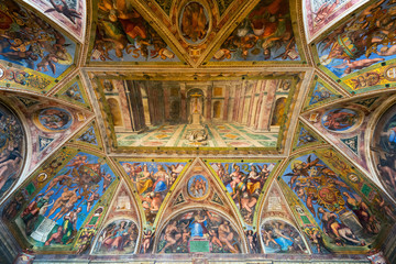 The ceiling in one of the rooms of Raphael in the Vatican Museum