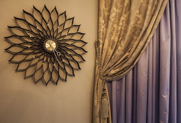 Wall Clock and Curtains with ornaments in the modern house