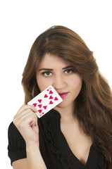 Beuatiful young woman playing cards