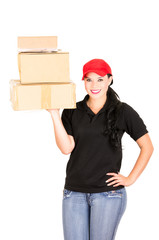 Beautiful smiling delivery girl holding packages