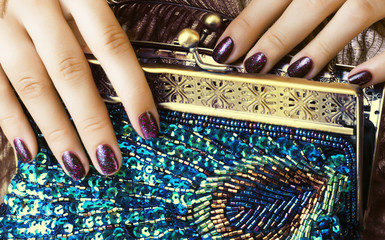 beauty woman fingers holding luxury bag